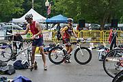 Matt Kowalewski (L) and Travis Moore during the T1 swin to  bike transition in the 2018 Hague Endurance Festival Olympic  Triathlon