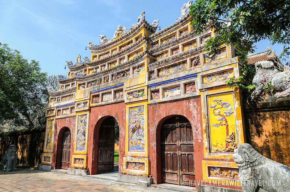 A gate at the Imperial City in Hue, Vietnam. A self-enclosed and fortified palace, the complex includes the Purple Forbidden City, which was the inner sanctum of the imperial household, as well as temples, courtyards, gardens, and other buildings. Much of the Imperial City was damaged or destroyed during the Vietnam War. It is now designated as a UNESCO World Heritage site.