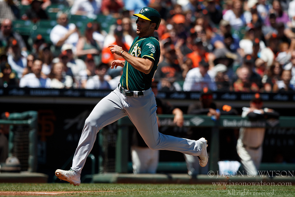 SAN FRANCISCO, CA - JULY 15: Stephen Piscotty #25 of the Oakland Athletics scores a run against the San Francisco Giants during the fourth inning at AT&T Park on July 15, 2018 in San Francisco, California. The Oakland Athletics defeated the San Francisco Giants 6-2. (Photo by Jason O. Watson/Getty Images) *** Local Caption *** Stephen Piscotty