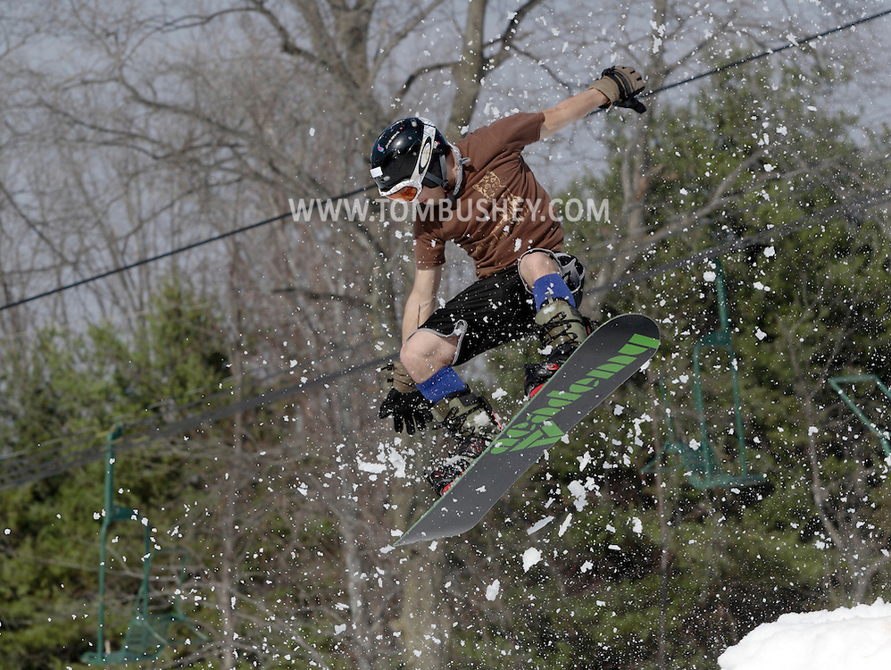 Warwick, New York - A snowboarder in shorts and tee shirt flies off the jump during the Big Air competition at the annual Spring Rally at Mount Peter Ski and Ride on March 21, 2010.