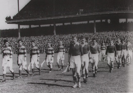 Mick Kenefick leads the Cork team against Antrim in 1943.