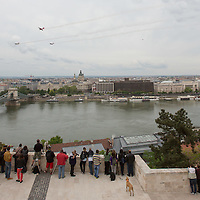 People watch as Zoltan Veres aerobatics European champion of Hungary and his formation team perform during an air show above river Danube crossing central Budapest, Hungary on May 01, 2016. ATTILA VOLGYI