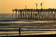 Sunset light over the pier and ocean waves at Pismo Beach, San Luis Obispo County coast, California