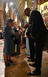 Queen Elizabeth II speaks with heavyweight boxer Anthony Joshua at the Commonwealth Service at Westminster Abbey, London on Commonwealth Day. The service is the Duke and Duchess of Sussex's final official engagement before they quit royal life.