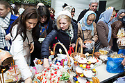London, UK. Saturday 19th April 2014. Easter celebration gathering of women at the Russian Orthodox Cathedral Church on Ennismore Gardens in West London. On this day before Easter Sunday Russians gather in a religious festival where their painted eggs; traditional cakes and other offerings are blessed. Then at midnight will be offered to God. Nothing is expected in retun in terms of good fortune.