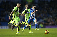 Brighton winger, Jamie Murphy (15) gets away from Huddersfield Town defender Joel Lynch (33) during the Sky Bet Championship match between Brighton and Hove Albion and Huddersfield Town at the American Express Community Stadium, Brighton and Hove, England on 23 January 2016.