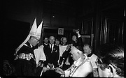 Archbishop Ryan Installed as Archbishop of Dublin..1972..27.02.1972..02.27.1972..27th February 1972..The installation of the Most Rev Dr Dermot Ryan as Archbishop of Dublin took place in The pro Cathedral,Dublin on Sunday 27th Feb 1972..Image of Dr Dermot Ryan accepting a symbol of office as he enters the Pro Cathedral,Marlborough Street,Dublin..