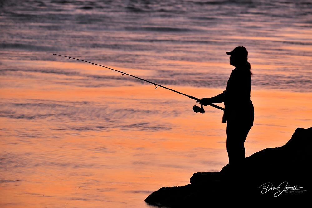 Fisherman at sunset, North Jetty and Nokomis Beach, N, Florida, USA