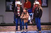 Children watch entertainment on Allen St., Helldorado Days, Tombstone, Arizona. ©Edward McCain/McCain Creative, Inc. All Rights Reserved 520-623-1998