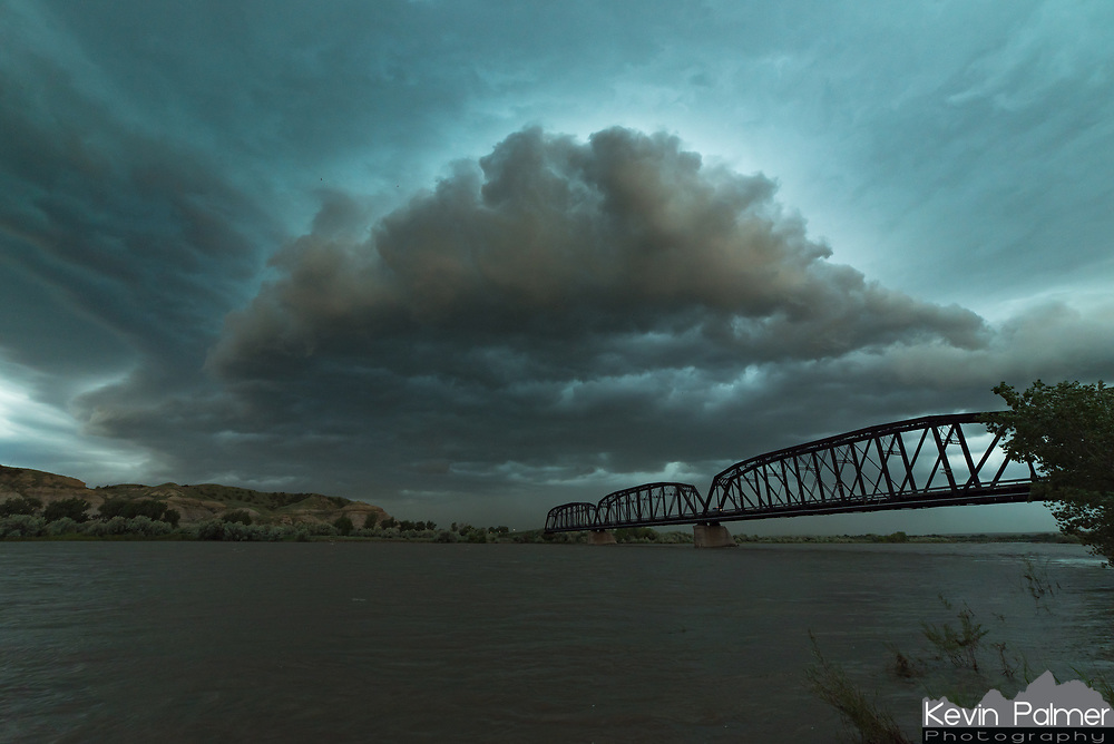 On this day a severe MCS (mesoscale convective system) roared across eastern Montana. Since I was out ahead of the storm near Miles City I had plenty of time to find an interesting place to watch it roll in. The Kinsey Bridge is a 4-span truss bridge that crosses the Yellowstone River. The single-lane bridge was built in 1907 and the poor condition made it unnerving to drive across. According to the National Bridge Inventory database, the Kinsey Bridge has a sufficiency rating of 56 out of 100 when it was last inspected. Just after 7PM the gust front passed overhead bringing with it strong winds, blowing dust, and heavy rain.