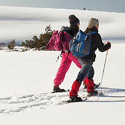 Two woman walking on snowshoes