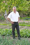In the kitchen vegetable potager garden. Nikos Kontosoros, The owner. Kontosoros restaurant and guest house, Xino Nero, Amyndeo, Macedonia, Greece