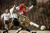 Thierry Henry (Arsenal) Alton Thelwell (Tottenham). Tottenham 1:1 Arsenal, FA Carling Premiership, 18/12/2000. Credit Colorsport / Stuart MacFarlane.
