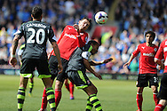Cardiff city's Jordon Mutch jumps over Stoke's Peter Odemwingie. Barclays Premier league match, Cardiff city  v Stoke city at the Cardiff city stadium in Cardiff, South Wales on Saturday 19th April 2014. pic by Andrew Orchard, Andrew Orchard sports photography,