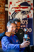 SHOT 12/10/17 12:23:56 PM - Former Buffalo Bills wide receiver and Hall of Fame player Andre Reed signs autographs and meets with fans at LoDo's Bar and Grill in Denver, Co. as the Buffalo Bills played the Indianapolis Colts that Sunday. Reed played wide receiver in the National Football League for 16 seasons, 15 with the Buffalo Bills and one with the Washington Redskins. (Photo by Marc Piscotty / © 2017)