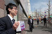 Office workers collect donations after a magnitude 9 earthquake and large tsunami hit the Tohoku region of north east Japan  on March 11th killing nearly 20,000 people and causing massive destruction along the whole coast, and a melt-down at the Fukushima Daichi nuclear power station. Shinjuku, Tokyo, Japan March 16th 2011