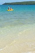 guests paddling a kayak in Hunga Lagoon, off Ika Lahi Lodge, Hunga Island, Vava'u, Kingdom of Tonga, South Pacific
