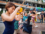 03 SEPTEMBER 2015 - BANGKOK, THAILAND:  People pray at Erawan Shrine Thursday. Repairs to Erawan Shrine were completed Thursday, Sept 3 after the shrine was bombed on August 17. Twenty people were killed in the bombing and more than 100 injured. The statue of the Four Faced Brahma in the shrine was damaged by shrapnel and a building at the shrine was damaged by debris.    PHOTO BY JACK KURTZ