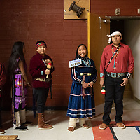 Students from Albert R. Lyman Middle School in Blanding, UT. Wait by the stairs before their performance for the 46th Annual Diné Song & Dance Festival at Rock Point Community School. In Rock Point on Wednesday.