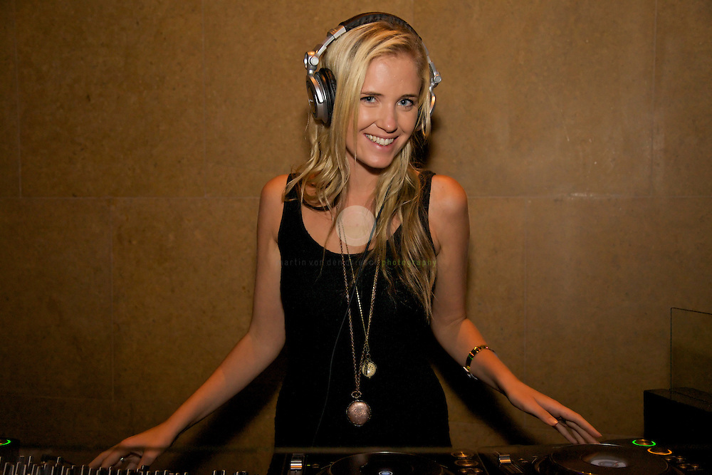 The female DJ entertaining the party guests.