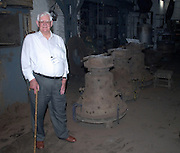 UK - Friday, Aug 01 2008:  Brian Horrell stands next to the 3 bells cast at the Whitechapel Bell Foundry in London that afternoon. (Photo by Peter Horrell / http://www.peterhorrell.com)