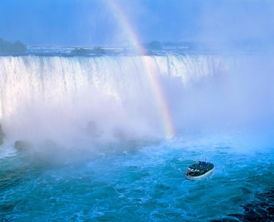 At the base of Niagara Falls, the Maid of the Mist glides through the churning water of Horseshoe Falls, Niagara Falls, New York.