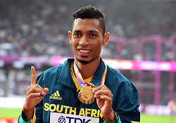 South Africa's Wayde Van Niekerk with his Gold medal from the Men's 400m during day six of the 2017 IAAF World Championships at the London Stadium. PRESS ASSOCIATION Photo. Picture date: Wednesday August 9, 2017. See PA story ATHLETICS World. Photo credit should read: Martin Rickett/PA Wire. RESTRICTIONS: Editorial use only. No transmission of sound or moving images and no video simulation