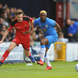 TELFORD COPYRIGHT MIKE SHERIDAN 16/2/2019 - Ryan Barnett of AFC Telford (on loan from Shrewsbury Town Football Club) battles for the ball with Darren Stephenson of Stockport during the Vanarama Conference North fixture between Stockport County and AFC Telford United at Edgeley Park