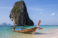 Railay also spelled Rai Leh, is a peninsula between the city of Krabi and Ao Nang. It is accessible only by boat because of limestone cliffs that shut off access. The cliffs attract rock climbers from all around the world.  The peninsula is very popular because of its pristine beaches.  East Railay is mostly mangroves, with a few hot spots for rock climbers.  West Railay Beach, connected to the east side by trails through the jungle is the main destination for beach lovers in Railay. The beach, is framed by high limestone cliffs on both ends.  Longtail boats are available to hire for transport to Ao Nang, Ko Phi Phi and Krabi Town.