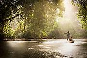 Men Canoeing Lekoli River.