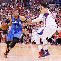 11 May 2014: Oklahoma City Thunder guard Russell Westbrook (0) drives past Los Angeles Clippers forward Danny Granger (33) during the Los Angeles Clippers 101-99 victory over the Oklahoma City Thunder, during Game Four of the Western Conference Semifinals of the NBA Playoffs, at the Staples Center, Los Angeles, California, USA.