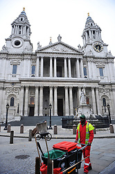 A street cleaner in front of St Paul's Cathedral, London