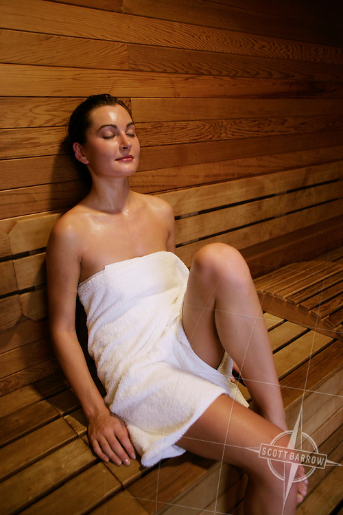 Woman sitting in the sauna at a spa