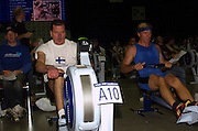 2004 British Indoor Rowing Championships. NIA. Birmingham. England. 21.11.2004.Race 17 M40-44 Antii Niskenen Finnrowing [White vest] and Andreas j.j.van Tonder, Supercanoa [all blue].[Mandatory Credit Peter Spurrier/ Intersport Images]