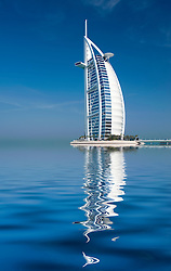 Burj al Arab luxury hotel seen reflected in water in Dubai United Arab Emirates
