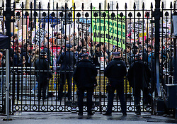 © Licensed to London News Pictures. 04/02/2017. London, UK. The protest passes the gates of Downing Street as Thousand of protestors take part in a demonstration against U.S President Donald Trump's Executive Order banning refugees and immigrants from a number of Muslim-majority countries. Protestors join campaign groups including Stop the War, Stand up to Racism, Muslim Association of Britain, in a march from the U.S Embassy in London to Downing Street. Photo credit: Ben Cawthra/LNP
