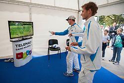 Grega Zemlja and Blaz Rola playing Wii during Davis Cup Slovenia vs. South Africa on September 13, 2013 in Tivoli park, Ljubljana, Slovenia. (Photo by Vid Ponikvar / Sportida.com)
