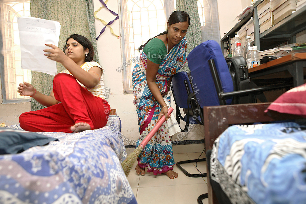 Sukanti Singh, 37, (right) the mother of Budhia Singh, 6, the famous Limca World Record marathoner, is working as a sweeper at the Kalinga Institute of Industrial Technology girls' hostel in Bhubaneswar, the capital of Orissa State, on Friday, May 16, 2008. On May 1, 2006, Budhia completed a record breaking 65 km run from Jagannath temple, Puri to Bhubaneswar. He was accompanied by his coach Biranchi Das and by the Central Reserve Police Force (CRPF). On 8th May 2006, a Government statement had ordered that he stopped running. The announcement came after doctors found the boy had high blood pressure and cardiological stress. As of 13th August 2007 Budhia's coach Biranchi Das was arrested by Indian police on suspicion of torture. Singh has accused his coach of beating him and withholding food. Das says Singh's family are making up charges as a result of a few petty rows. On April 13, Biranchi Das was shot dead in Bhubaneswar, in what is believed to be an event unconnected with Budhia, although the police is investigating the case and has made an arrest, a local goon named Raja Archary, which is now in police custody. **Italy and China Out**