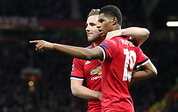 Manchester United's Marcus Rashford (right) celebrates scoring his side's second goal with team-mate Luke Shaw during the UEFA Champions League match at Old Trafford, Manchester.