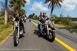 Kissa Von Adams on her custom Evo beside Jay Allen and Danielle VanDeventer on Jay's Shovelhead as they ride into Tomoka State Park during Daytona Bike Week. FL. USA. Sunday March 18, 2018. Photography ©2018 Michael Lichter.