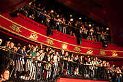 Enraptured audience at a gig at KOKO. KOKO is a nightclub in a former theatre in Camden Town, London, UK, at the bottom of Camden High Street close to Mornington Crescent. Until 2004 it was called the Camden Palace. The building is considered to have some architectural significance and is a Grade II listed building. Now it is a live music venue of great reputation with it's many leveled tiered shape it provides a large but intimate space.