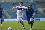 Ollie Rathbone wins a challenge  during the EFL Sky Bet League 1 match between Gillingham and Rochdale at the MEMS Priestfield Stadium, Gillingham, England on 30 March 2019.