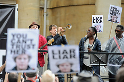 "© Licensed to London News Pictures. 02/06/2017. London, UK. The band Captain Ska plays their song Liar Liar live as demonstrators gather outside the BBC headquarters in protest against the Corporation for not playing the song ""Liar Liar"" by Captain Ska on BBC Radio 1.  Organised by The People's Alliance, people carried signs bearing an image of Prime Minister Theresa May with the words ""Liar Liar"" and ""You Can't Trust Her"" on each side.   Photo credit : Stephen Chung/LNP"