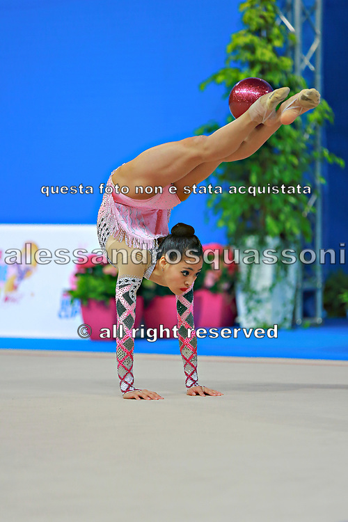 """Lu Serena during ball routine at the International Tournament of rhythmic gymnastics """"Città di Pesaro"""", 10 April, 2015. Serena born on April 30, 1998 in  Minneapolis, is a rhythmic gymnast of Usa.<br /> This tournament dedicated to the youngest athletes is at the same time of the World Cup."""