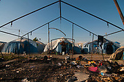 A burnt tent is seen in the old camp after a fire in July that hit the Rosarno ghetto on August 9, 2017 in Reggio Calabria, Italy.The San Ferdinando Camp, better known as the Rosarno ghetto, is located in the Plain of Gioia Tauro and hosts 600 migrants in summer, and as many as 2000 in winter. Living conditions in the camp are now appalling due to the recent hot weather in southern Italy, and have further deteriorated after a fire in July destroyed two-thirds of the camp, making it virtually uninhabitable on health and humanitarian grounds. Italian Civil Protection is building the new camp that will host up to 600 people. ©Simone Padovani