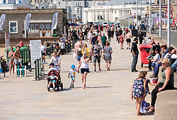 © Licensed to London News Pictures; 02/06/2020; Weston-super-Mare, UK. The beach promenade is quieter on a Tuesday than at the weekend or bank holiday. People at the beach after some lockdown restrictions due to the coronavirus covid-19 pandemic have been lifted by the UK Government. People can spend as long outdoors as they want and can meet in groups of up to six people from different households as long as they maintain social distancing of 2m or more. Photo credit: Simon Chapman/LNP.