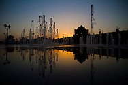 Silhouetted fountains at sunset at the Emirate Palace Hotel, Abu Dhabi, UAE.