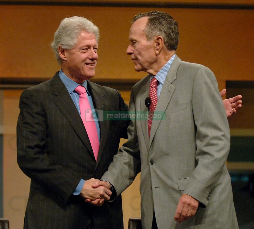 Former president Bill Clinton (left welcomes former president George H.W. Bush to the stage during their joint appearance at the CTIA Wireless 2007 convention at the Orange County Convention Center in Orlando, Florida, Thursday, March 29, 2007. Photo by Joe Burbank/Orlando Sentinel/MCT/ABACAPRESS.COM
