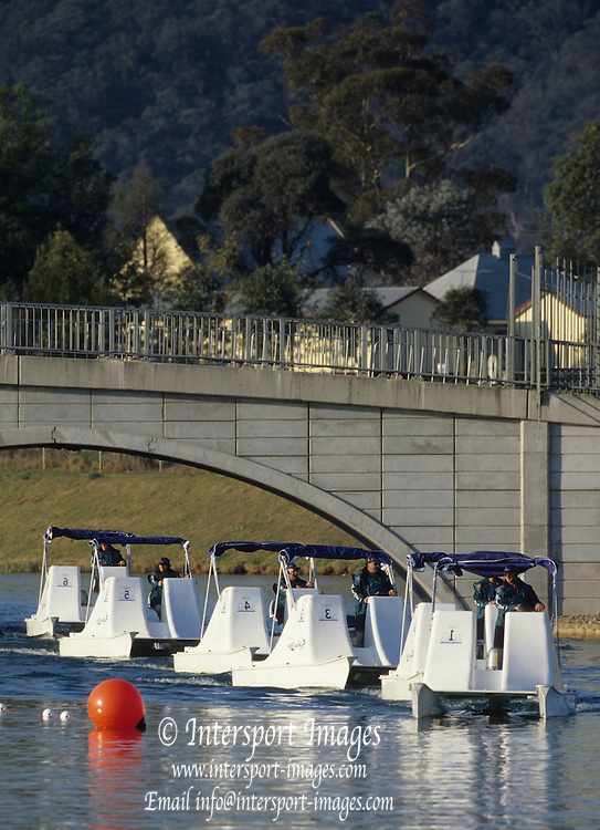 Sydney, AUSTRALIA, Course Installations, Umpires launches pass under the bridge linking the Administration Island,  Penrith's, West Lakes venue for the 2000 Olympic Regatta. Crews Boating and training   2000 Olympic Regatta, West Lakes Penrith. NSW.  [Mandatory Credit. Peter Spurrier/Intersport Images] Sydney International Regatta Centre (SIRC) 2000 Olympic Rowing Regatta00085138.tif
