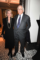SIR EVELYN & LADY DE ROTHSCHILD at the Liberatum Dinner hosted by Ella Krasner and Pablo Ganguli in honour of Sir V S Naipaul at The Landau at The Langham, Portland Place, London on 23rd November 2010.